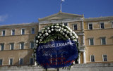 Employees of municipalities of Attica demonstrate outside the Parliament against the new  austerity measures, carrying wreath with the name of Prime Minister Antonis Samaras depicting  the government`s  funeral. In Athens on 22, 2012  / Εργαζόμενοι των δήμων της Αττικής διαδηλώνουν κατά των νέων μέτρων, μεταφέροντας στεφάνι με το ονομα του Πρωθυπουργού  αναπαριστώντας την κηδεία της Κυβέρνησης