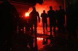 Fans of the ultra -right Golden Dawn welcome the partys Secretary General  during event at the partys offices in Aspropyrgos. On Tuesday, December 4 an explosion occurred in the same offices causing damage but no casualties. On December 5, 2012  /  Οπαδοί της  Χρυσής Αυγής υποδέχονται τον Γενικό Γραμματέα  του κόμματος κατά τη διάρκεια της εκδήλωσης στα γραφεία κόμματος στον Ασπρόπυργο. Την Τρίτη 4 Δεκεμβρίου έκρηξη σημειώθηκε στα ίδια γραφεία προκαλώντας ζημιές αλλά όχι θύματα.