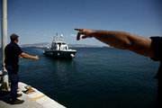 """Images from the island of Salamis on September 14, 2017. Pollution is spread in the Saronic Gulf, south of Athens, after a small tanker sank in the early hours of Sunday morning, the tanker """"Agia Zoni II"""" is thought to have been carrying 2,200 metric tons of fuel oil and 370 metric tons of marine gas oil. / Ρύπανση στο Σαρωνικό μετά τη βύθιση δεξαμενοπλοίου. Εικόνες απο την ακτή μεταξύ Κυνοσούρας και Σεληνίων, Σαλαμίνα 14 Σεπτεμβρίου 2017. Αφιξη στην Σαλαμίνα των Σ. Θεοδωράκη, Σ. Φάμελλου, Π. Κουρουμπλή με σκάφη του Λιμενικού"""