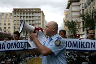 Greek police officers demonstrate in Athens