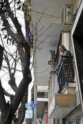 Elderly man on the balcony of his home, Athens, Greece, 2013 / Ηλικωμένος άντρας στο μπαλκόνι του σπιτιού του, Αθήνα, 2013