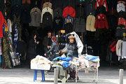 Woman trying on clothes in discount, Athens, Greece, 2013 / Γυναίκα δοκιμάζει ρούχα από καλάθι προσφορών, Αθήνα, 2013