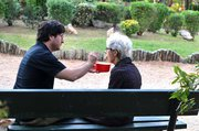 A man feeding an older woman, Athens, Greece, 2013 / Άντρας ταΐζει ηλικιωμένη γυναίκα, Αθήνα, 2013