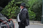Man charges the battery of his car, Athens, Greece, 2013 / Άντρας φορτίζει την μπαταρία του αυτοκινήτου του, Αθήνα, 2013