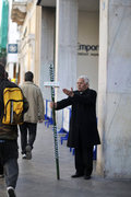 Elderly man selling lottery tickets on sidewalk, downtown Athens, Greece, 2013 / Λαχειοπώλης, Αθήνα, 2013
