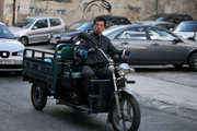 Chinese man in cargo tricycle, downtown Athens, Greece, 2013 / Κινέζος σε τρίκυκλο, Αθήνα, 2013