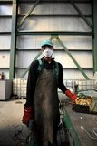Worker wearing protective mask against hazardous substances dismantles appliances at the Hellenic Recycling Center at Agioi Theodoroi in Attica / Εργάτης με μάσκα προστασίας από τα βαρέα μέταλλα και τις αναθυμιάσεις διαλύει ηλεκτρονικές συσκευές, στη μονάδα ανακύκλωσης ηλεκτρικών και ηλεκτρονικών συσκευών ΕΚΑΝ, Άγιοι Θεόδωροι Αττικής
