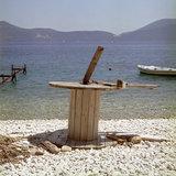 Wooden spool abandoned at Horgotas beach in Komitata, Erissos area, Island of Kefalonia, Greece, August 2011 / Ξύλινο καρούλι εγκαταλελειμμένο  στην παραλία Χοργοτά, Κομιτάτα Ερίσσου, Κεφαλονιά, Αύγουστος 2011