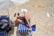 Female bather, Cephalonia, Ionian Islands, Greece, August 2016 / Λουόμενη σε ξαπλώστρα, Κεφαλονιά, Αύγουστος 2016