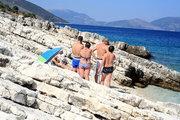 Bathers suntanning at a rocky beach, Cephalonia, Ionian Islands, Greece, August 2016 / Λουόμενοι κάνουν ηλιοθεραπεία, Κεφαλονιά, Αύγουστος 2016