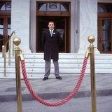 Porter of Hotel Grande Bretagne in Athens, Greece, June 2004 / Υπάλληλος μπροστά απο την είσοδο του ξενοδοχείου Μεγάλη Βρεταννία, Ιούνιος 2004