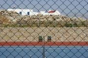 Tennis court in a luxurious villa, Mykonos, Cyclades Islands, Greece, July 2005 / Γήπεδο του τέννις πολυτελούς εξοχικής κατοικίας, Μύκονος, Κυκλάδες, Ιούλιος 2005