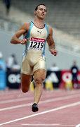 Kostas Kenteris, Greek champion sprinter, while running in the100m race at the National Athletics Championships in Olympic Stadium, Athens, Greece, June 2004 / Ο Κώστας Κεντέρης τρέχει στη κούρσα των100μ στο Πανελλήνιο Πρωτάθλημα Στίβου στο Ολυμπιακό Στάδιο, Αθήνα, Ιούνιος 2004