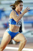 Katerina Thanou, Greek female champion sprinter, while running in the 4x100 relay race at the National Athletics Championships in Olympic Stadium, Athens, Greece, June 2004 / Η Κατερίνα Θάνου τρέχει στη σκυταλοδρομία 4Χ100 στο Πανελλήνιο Πρωτάθλημα Στίβου στο Ολυμπιακό Στάδιο, Αθήνα, Ιούνιος 2004