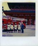 Firefighters pose for a souvenir photo at the entrance of japanese, traditional pagoda, Kyoto, Japan, 2006 / Πυροσβέστες ποζάρουν για μια αναμνηστική φωτογραφία στην είσοδο παγόδας, Κιότο, Ιαπωνία, 2006